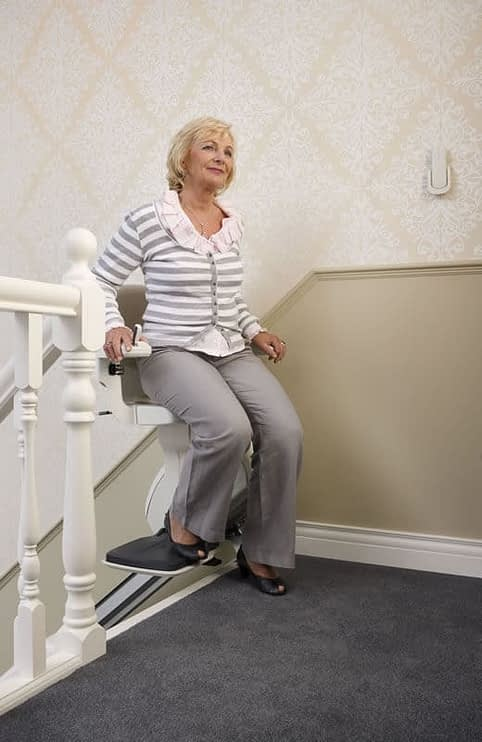 HomeGlide Straight Stairlift from 1st Choice Stairlifts swivel seat at the top of the stairs